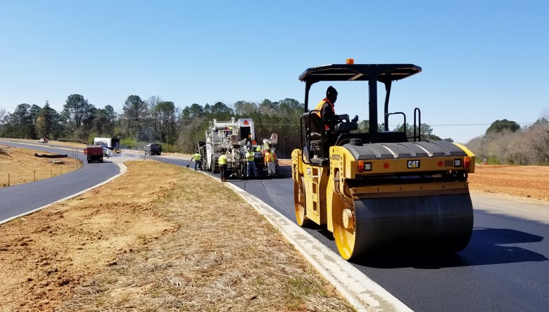 county vehicle equipment working on troup county roads